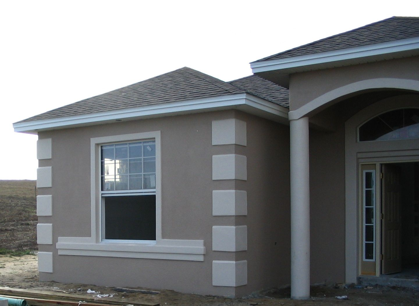 Stucco coin window ledge ocala faux finish color - How to paint exterior stucco house ...