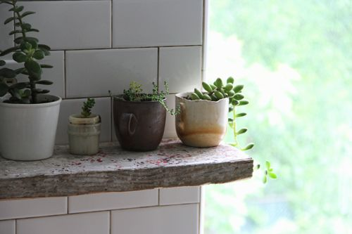 subway tile in the kitchen. small succulents. recycled wood. all hand done. beautifully simple.