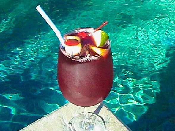 Applebee's Red Apple Sangria Recipe: 1/3 C cabernet sauvignon, 1 1/4 oz dekuyper apple liquer, 1 1/2 oz cranberry juice, 1 1/2 oz pineapple juice, sierra mist soda. fill 16 oz glass with ice fill with booze and juice, top off with sierra mist (or not)