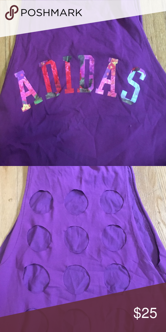 Adidas muscle tank! Purple Adidas muscle tank with the classic logo written in a floral design. The back has circle cut-outs. Only worn once or twice! Adidas Tops Muscle Tees