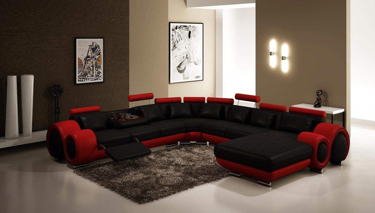 modern black sectional leather sofa with brown carpet on the ...