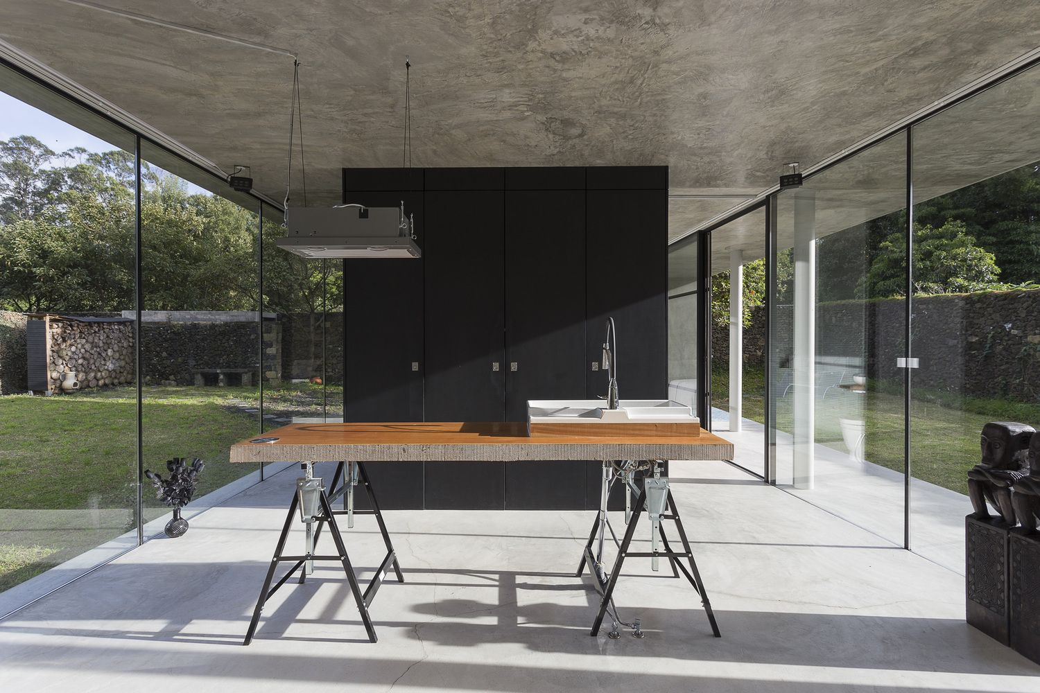 Striking concrete and glass home has a