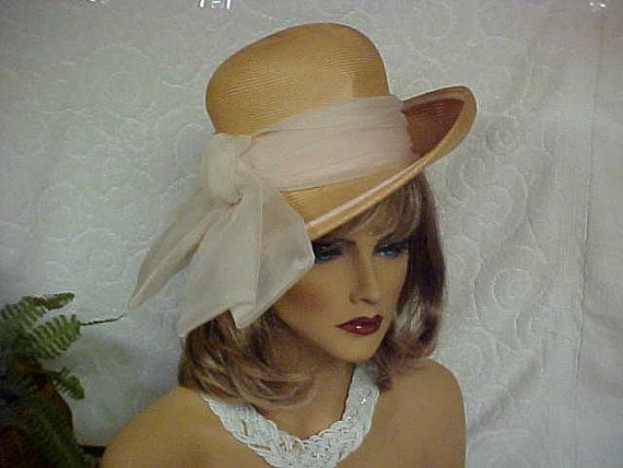 Beige straw hat with a tilted brim and white organza by designer2