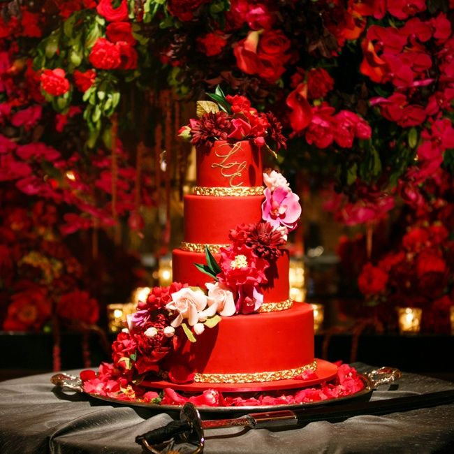 Beautiful Red wedding cake with gold accents and cascading sugar flowers | Photographer: Brian Dorsey  Studios | Cake: Ron Ben Israel | www.theknot.com