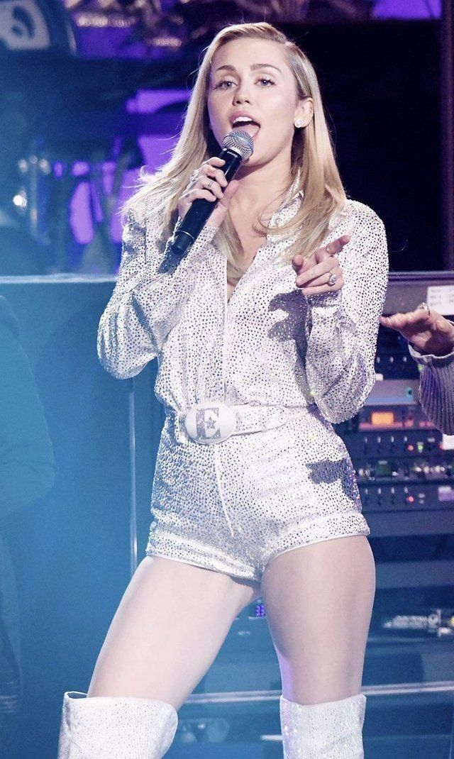 Miley Cyrus white & silver jumpsuit
