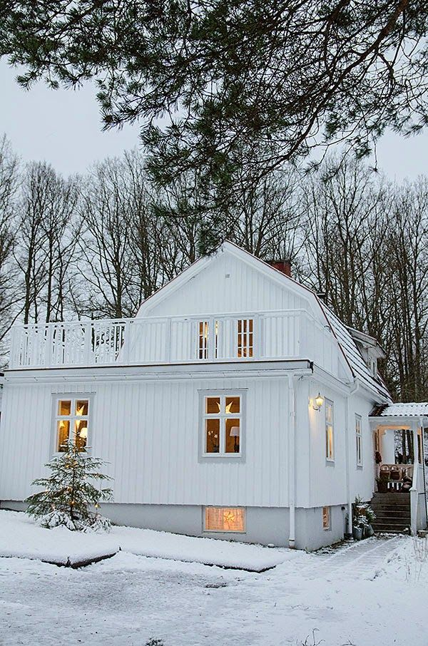 Dreamiest Scandinavian House Design Exterior Ideas 6: Twinkling Lights Beckon Guests In Out Of The Snow (Anna