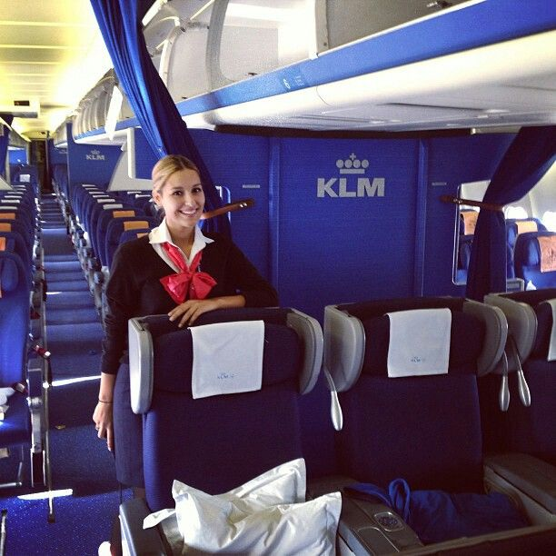 Air France airport customer services member onboard KLM aircraft