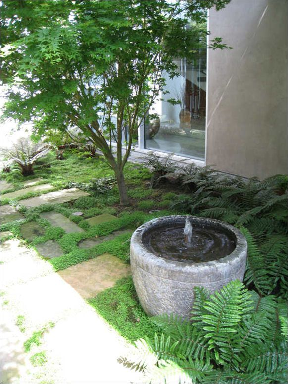 Simple And Tranquil Round Stone Garden Fountain