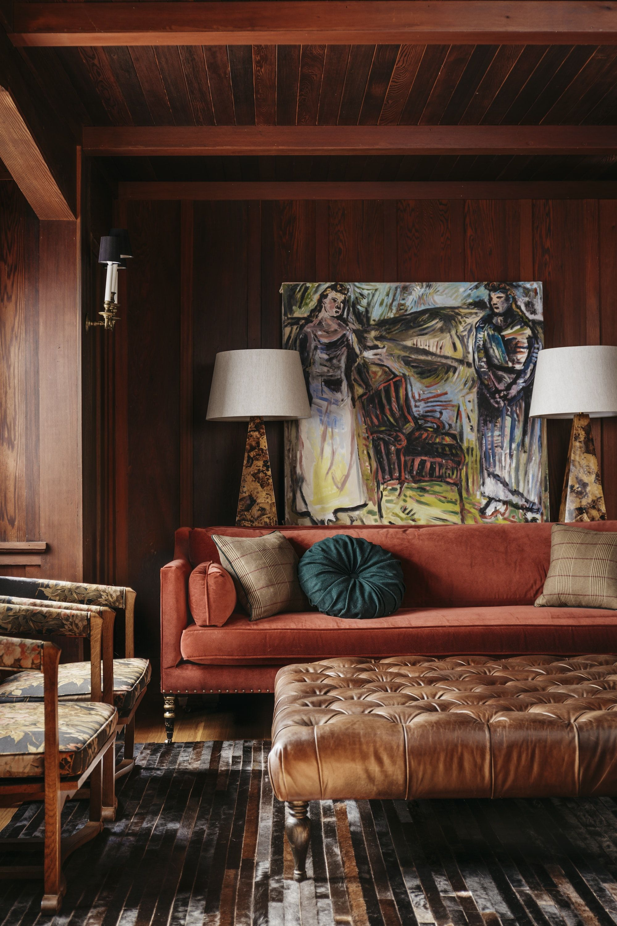 Craftsman Library With Bold Artwork Burnt Orange Sofa Leather Ottoman Florals By Idf Studio Living Room Designs Living Room Orange Interior Design