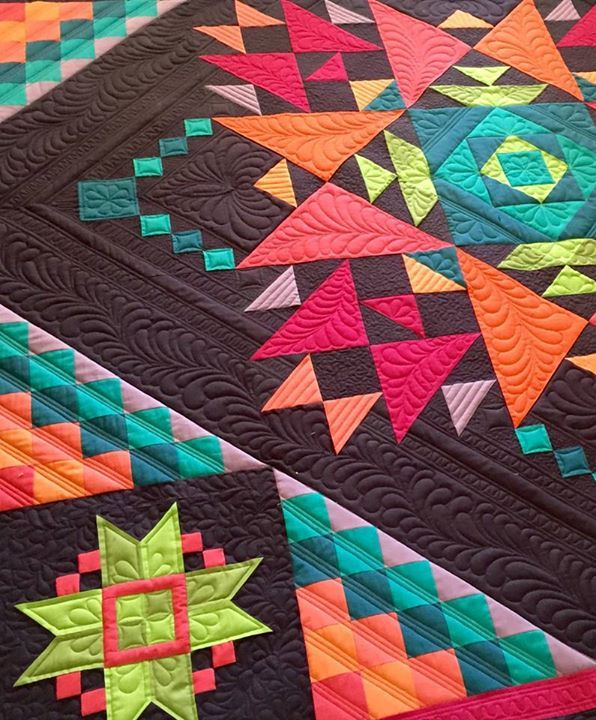 Lovely quilting. Wish I knew who the quilter is....anybody know?