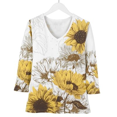 A dynamic sunflower print brings nature's beauty front and center on this scenic, white, 100% cotton tee! The three-quarter length sleeve tee features a flattering, relaxed fit. Machine washable. Imported. Available in adult sizes: (S-3X) $34.99.