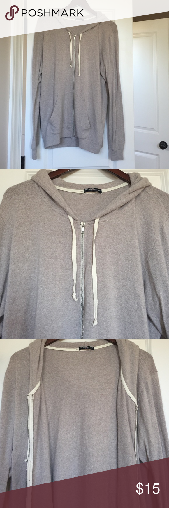 Brandy Melville Oversized soft hoodie NWOT Brandy Melville oversized gray zip up hoodie that's super super soft and comfy, perfect condition, never worn, comfy hood! Brandy Melville Tops Sweatshirts & Hoodies