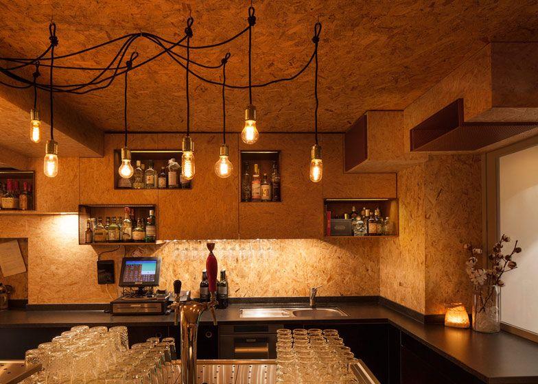 Ninetynine creates chipboard interior for Amsterdam\'s Mash bar ...