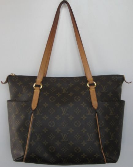 f6bf0e3d6ab5 Louis Vuitton signature monogram canvas  Totally MM  tote. Multi brown  canvas with 2 outside slip pockets on either side. Feature top zip closure  with 2 ...