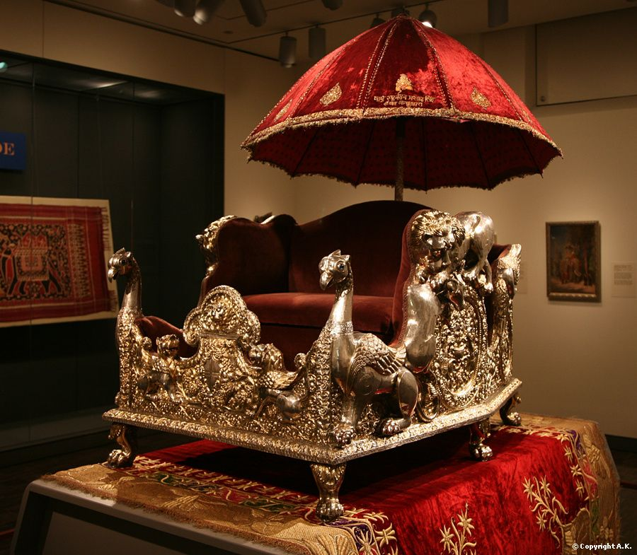 Elephant throne (howdah) with parasol - Elephants on parade - Asian Art Museum of San Francisco Material : Curved wood, Silver, Velvet.  approx. between 1870 and 1920