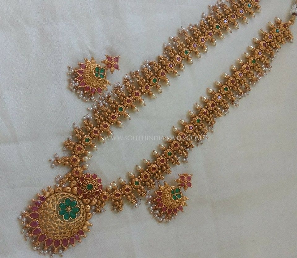 255da19a8ab Long Ruby Emerald Haram With Earrings. Check out more such stunning designs  on our catalogue.