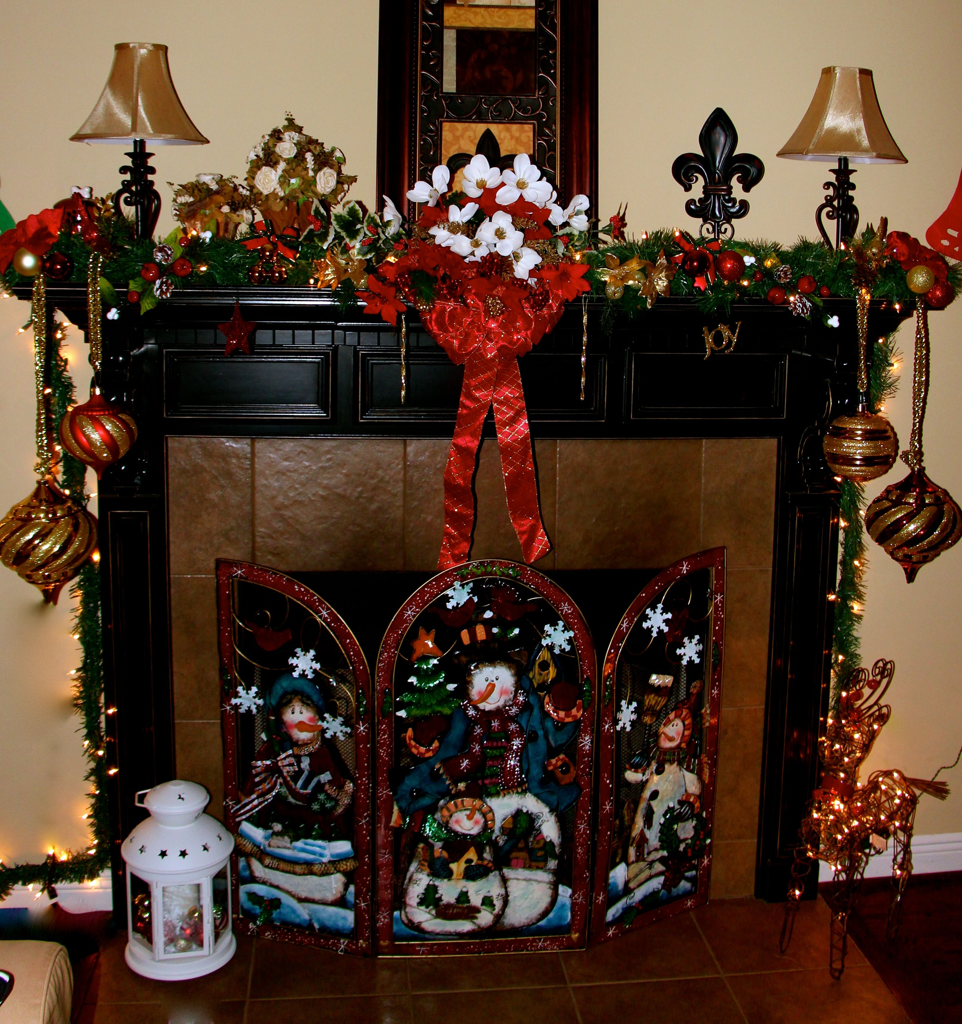 My affordable Christmas decoration this year. Fireplace mantel: 4 garlands from the Dollar Tree, half every one and twist them together, light up garland at last, for the center piece just put some christmas stems in there as well as some ornaments, also from the Dollar Tree, the big ornaments are 3-4$ at Big Lots. There you go, for about 35$!  Happy Holidays