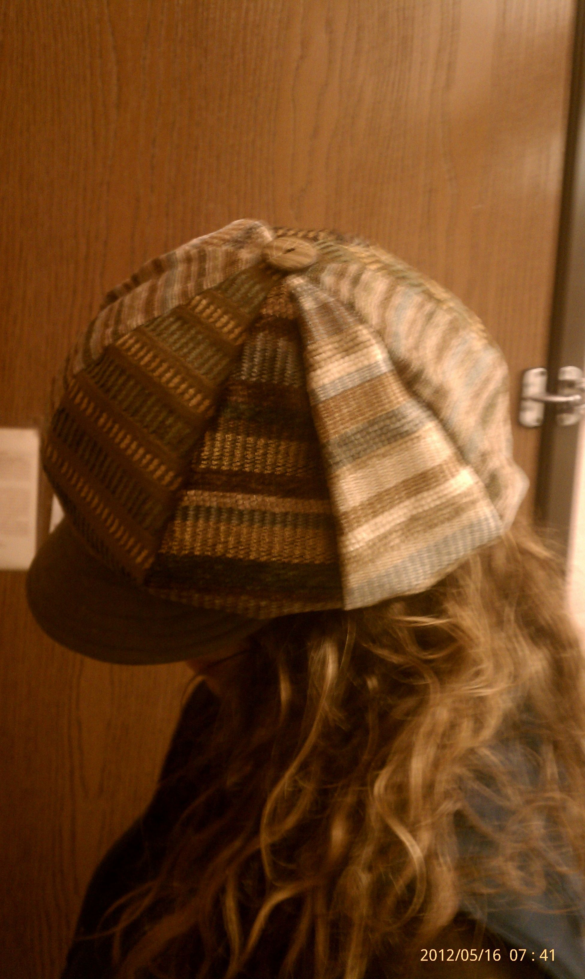 Hat made from repurposed couch fabrics.