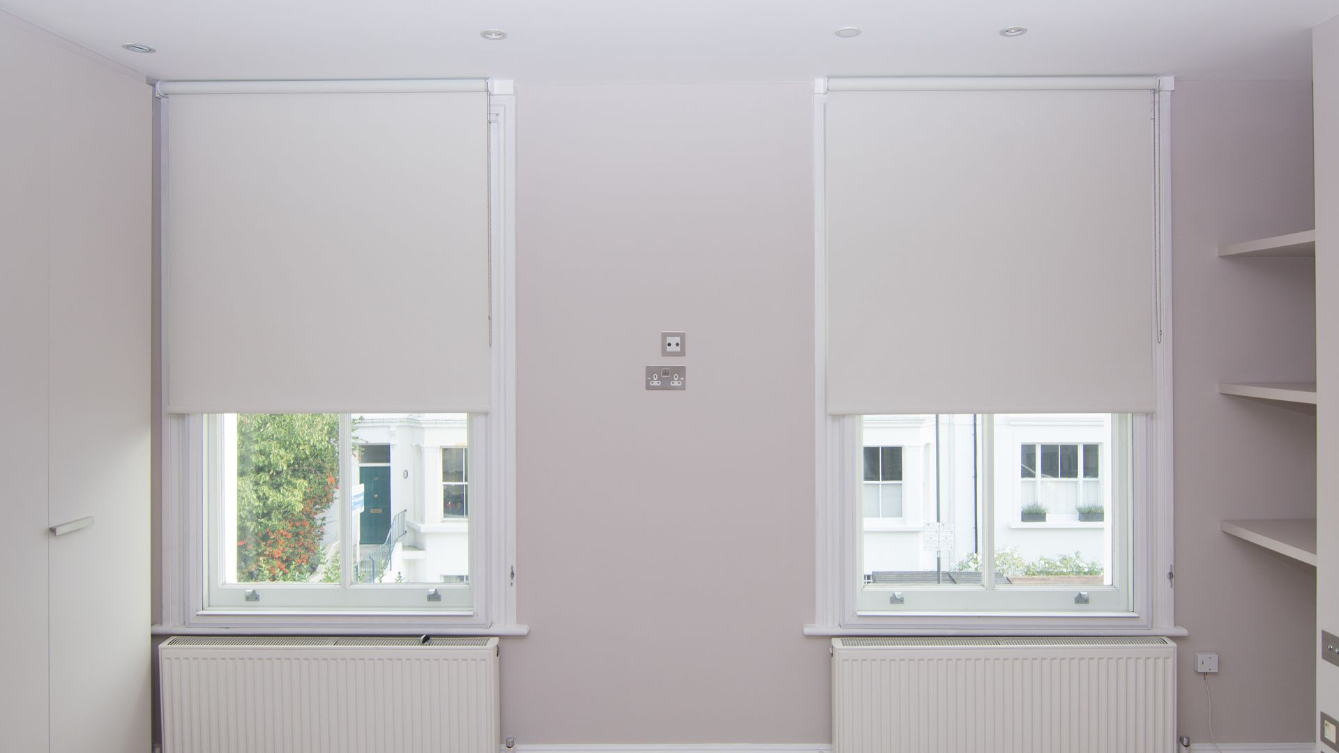Blackout Roller Blinds In White Fitted To Bedroom Sash