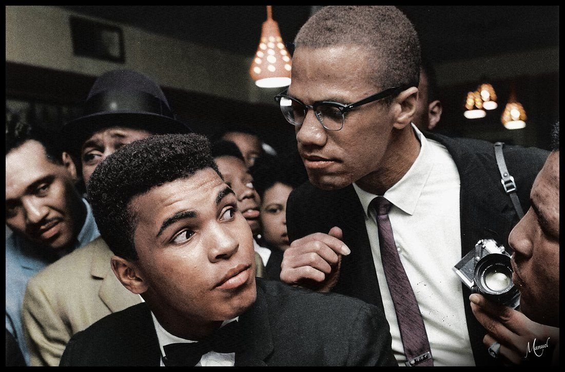 Malcolm X chats with Muhammad Ali.