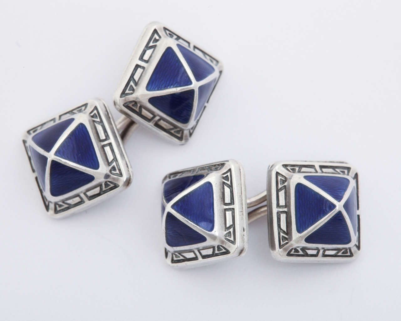 Guilloche Enamel Sterling Silver Cufflinks. Square with a divided blue pyramid and geometric silver border. Hallmarks: STERLING/ maker's mark of column wrapped around an axe. 1920-30s