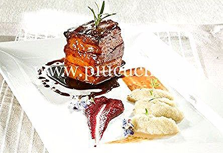 Photo of Cube of bacon lacquered with red turnip cream and …