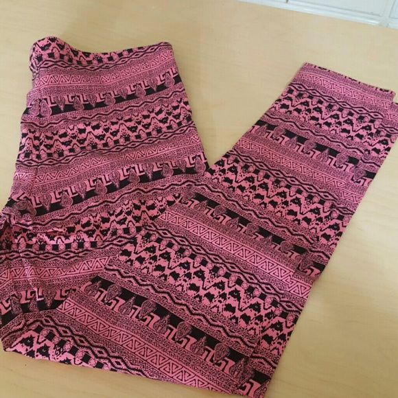 """Pink Rose tribal Leggins Pants. NWT.  Pink and Black Tribal Patterned. 95% cotton. 5% Spandex. 34"""" from waist to bottom of leg.  26"""" inseam. 15 1/2"""" elastic waist.  Great for exercising Pink Rose Pants Leggings"""