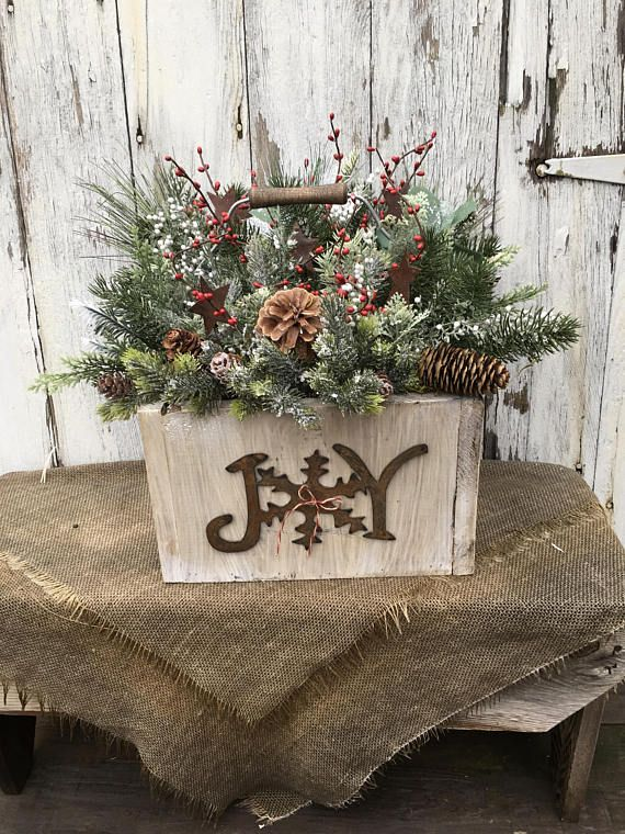 A Winter Or Christmas Arrangement In A Primitive Wooden