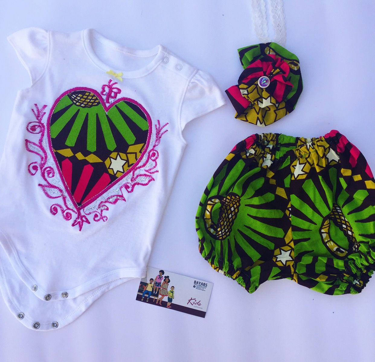 African Fashion for Babies. Onesie set with embroidery made with African wax Print. African print clothing for babies made by BAYABS. Find more baby style on Facebook: BAYABS and @bayabsgh_kids on Instagram Wax prints  African Print  Diaper Bag  African Textile  baby style  onesie
