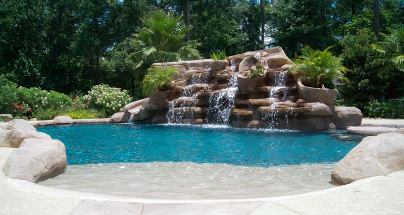 Pics Photos - Beach Entry Pool With Rock Features | Swimming pool ...