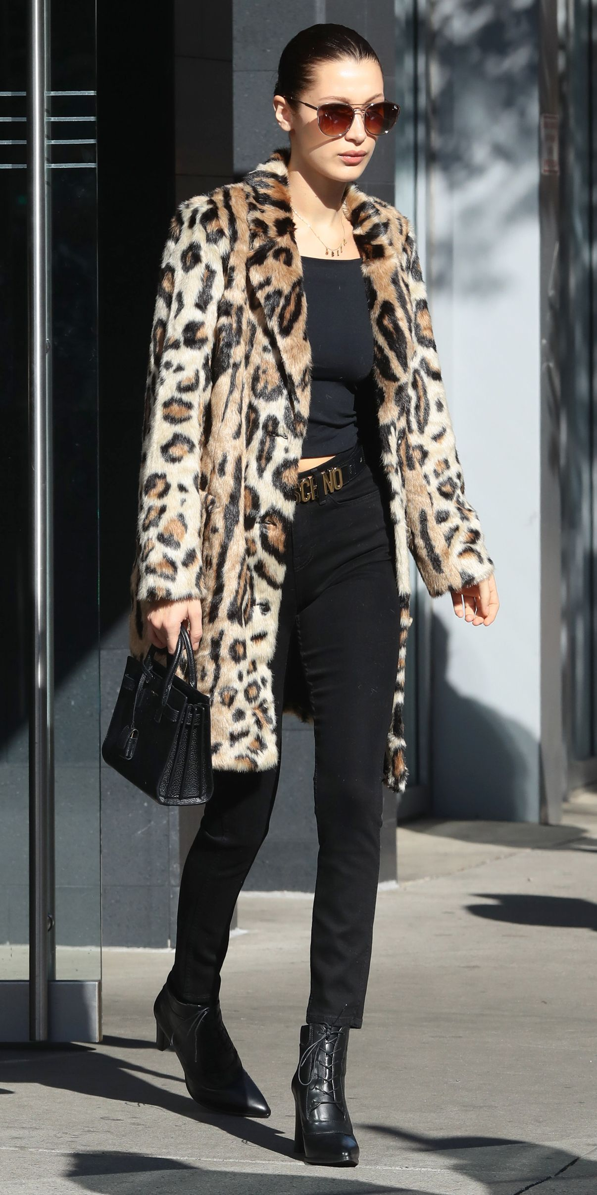 a22c0b1782e 12 Celebrity Images to Convince You That You Need a Leopard-Print Coat -  Bella Hadid from InStyle.com