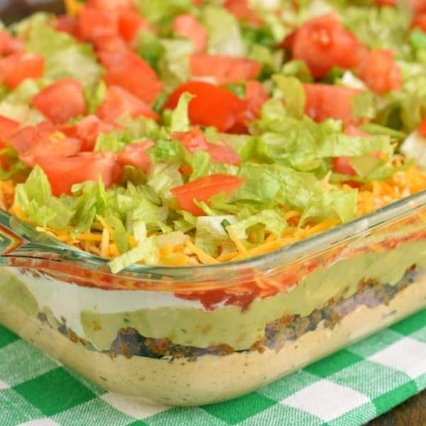 The Best 7 Layer Dip Recipe {with or without meat} #7layerdip The Ultimate 7 Layer Dip recipeis packed with layers of Cream Cheese, Sour Cream, Ground Beef (and/or Beans), Guacamole, Salsa, Cheese, and more! #7layerdip
