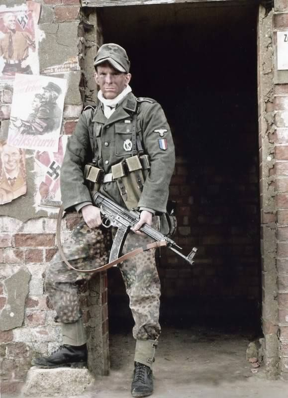 Frenchman of the 'Charlemagne' 33rd Waffen-SS Grenadier Division, originally the 'Legion of French Volunteers Against Bolshevism'. This re-enactor's  holding a Sturmgewehr r44. Frenchmen were, ironically, among the last troops still fighting in defence of central Berlin and the Führerbunker against the Soviet invasion.