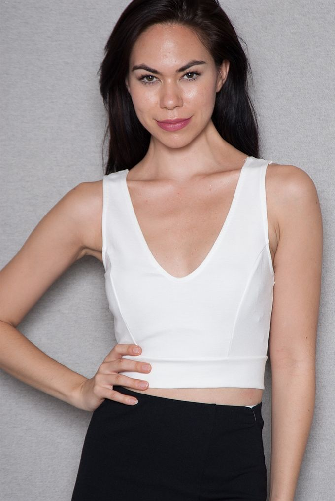 7de90b6eb91 This white cropped tank top adds ladylike luxe to your crop top collection  Tank front has
