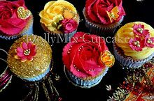 Gold glitter cupcake decoration, but with brighter colored frosting & flowers