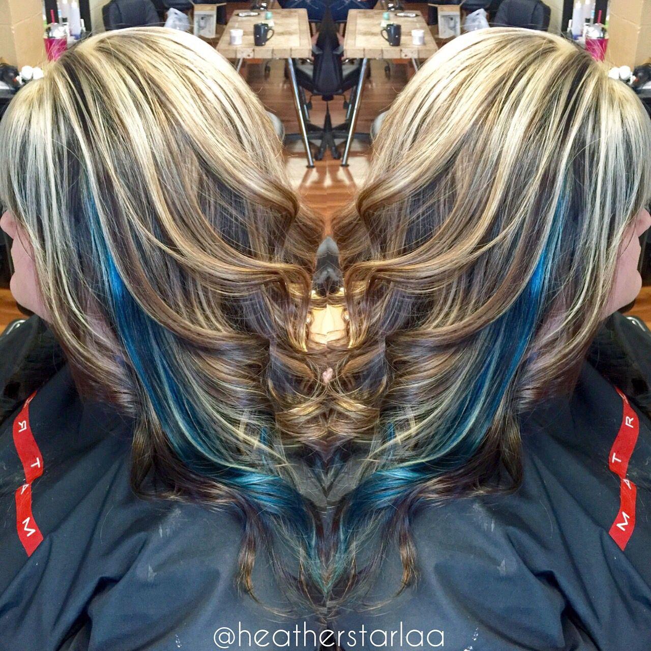 Blonde Highlights With A Dark Brown Base And Blue Peekaboos Blonde Hair Curled Hair Blue Hair Brown Blonde Highlights Blonde And Blue Hair Hair Highlights