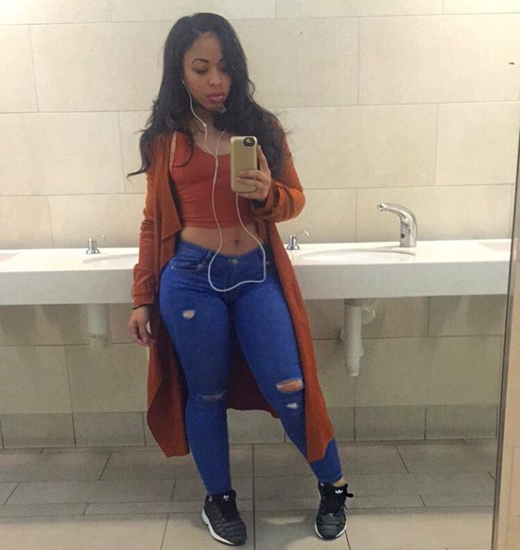 e2b0438d2b Beautiful black woman showing her beauty in skin tight ripped blue jeans  and orange top.  blackwoman  jeans