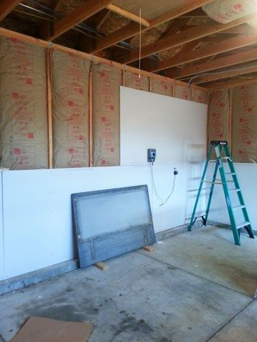 Finishing The Garage Part 1 Insulating And Drywalling Walls And Ceiling Garage Bedroom Garage Interior Finished Garage
