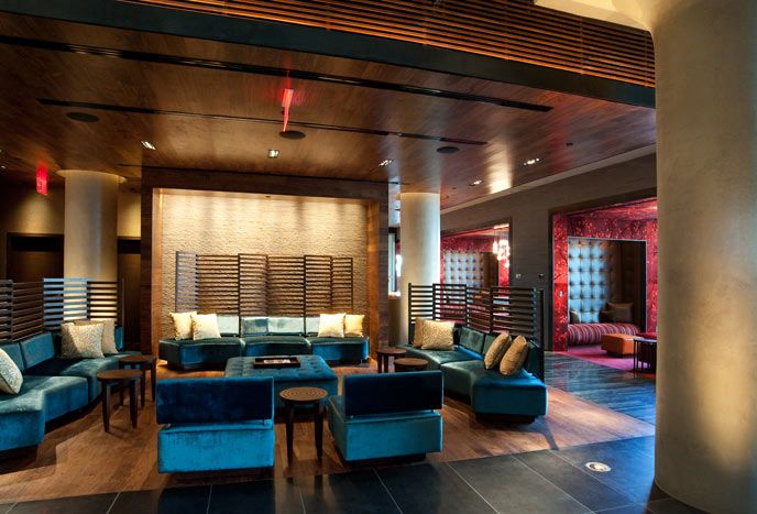 The hotels lobby is decorated with textured stone walls wooden