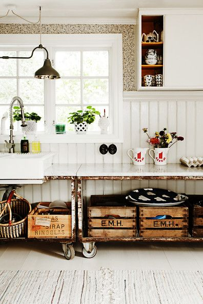 Storage idea: Wooden crates on rolling carts converted into work surfaces.  Click for more great kitchen storage solutions!