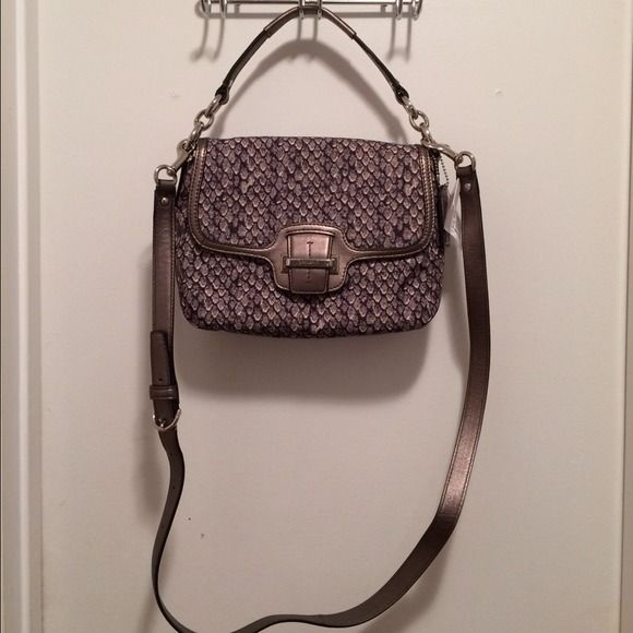 Coach F23036 Gray Snake Print Satchel Bag Silver hardware.  Cross body strap.  Tote handle.  Hang tag.  1 back exterior pocket.  1 pocket under flap.  Main compartment has 2 pockets (1 zips).  278 retail.  Measures: 9x2.25x7.25x5 and 23. Coach Bags Satchels