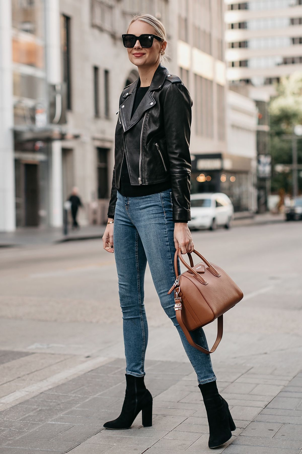 ca17665d3b05 Blonde Woman Wearing Black Leather Jacket Denim Skinny Jeans Black Booties  Givencny Antigona Cognac Satchel Fashion Jackson Dallas Blogger Fashion  Blogger ...