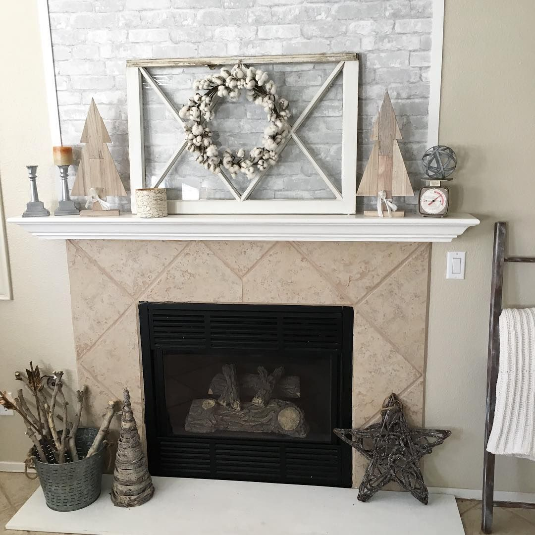 Grey Faux Brick Peel And Stick Wallpaper Above A Fireplace Faux Brick Wallpaper Interior Design Living Room Brick Wallpaper Fireplace