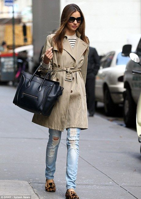 Miranda Kerr wearing A.P.C. Striped Merino Ribbed Pullover, Celine Audrey Sunglasses, Cartier Juste Un Clou Nail Bracelet, Mango Jeans Slim Roto Decorativo, Celine Boston Bag and Prada Logo-Studded Tassel Loafer.