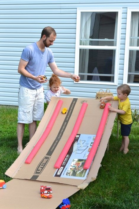repurposing a pool noodle and cardboard box into a car race track!