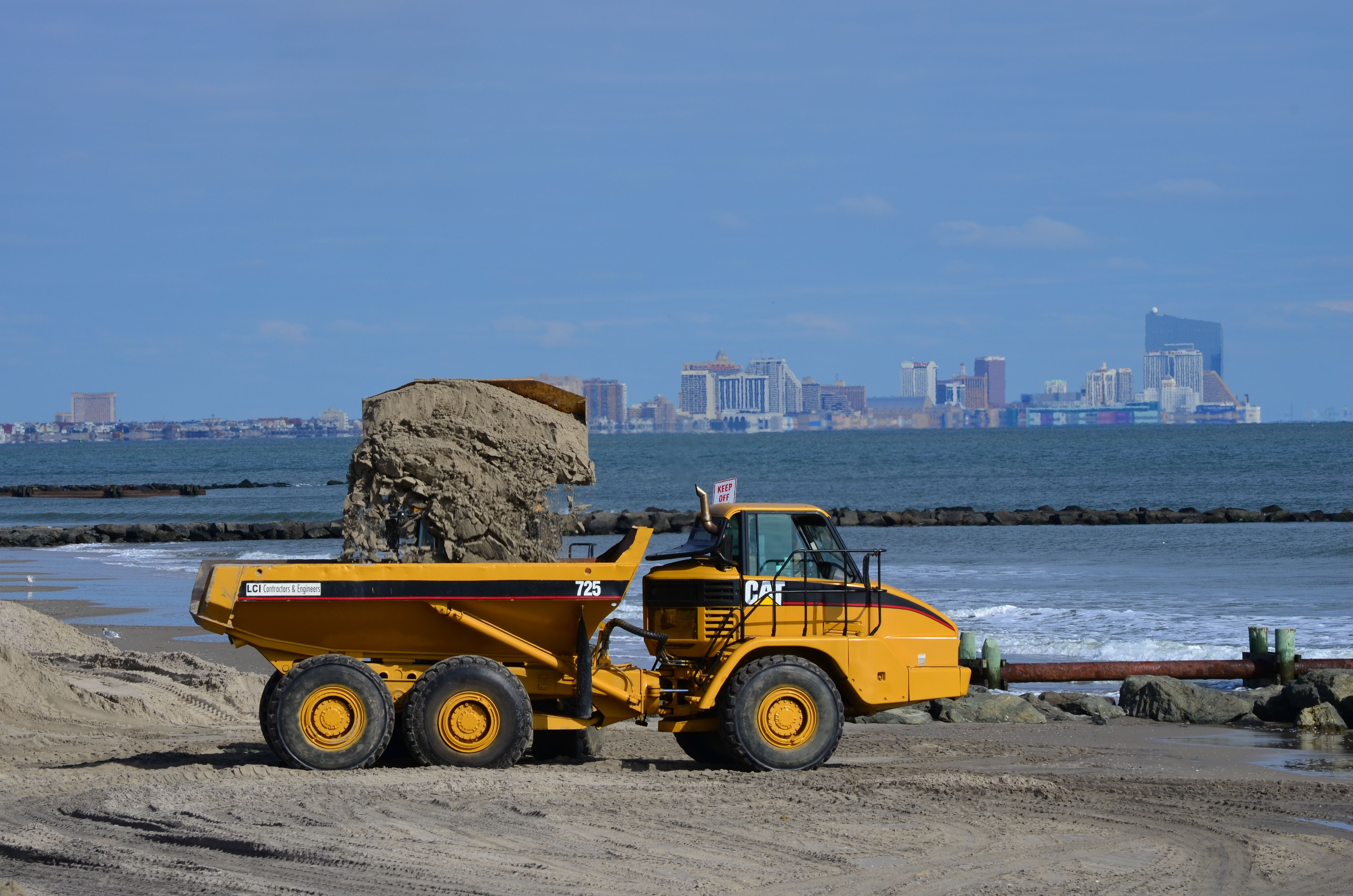 CAT 725 Articulated Dump Truck Taking Sand from CAT 950G Wheel Loader, with Atlantic  City