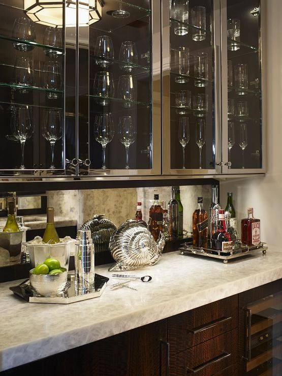 Kitchen Bar Features Stainless Steel Upper Cabinets With Glass