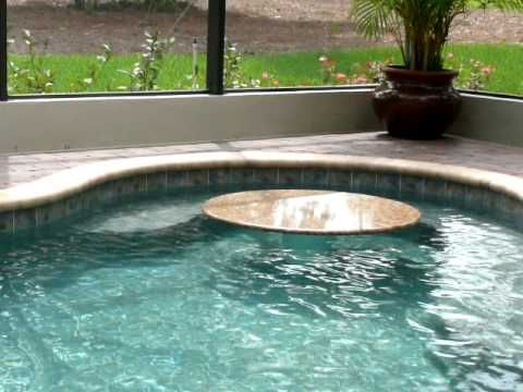 Swimming pool featuring a rock waterfall and a marble - Small pool table ...