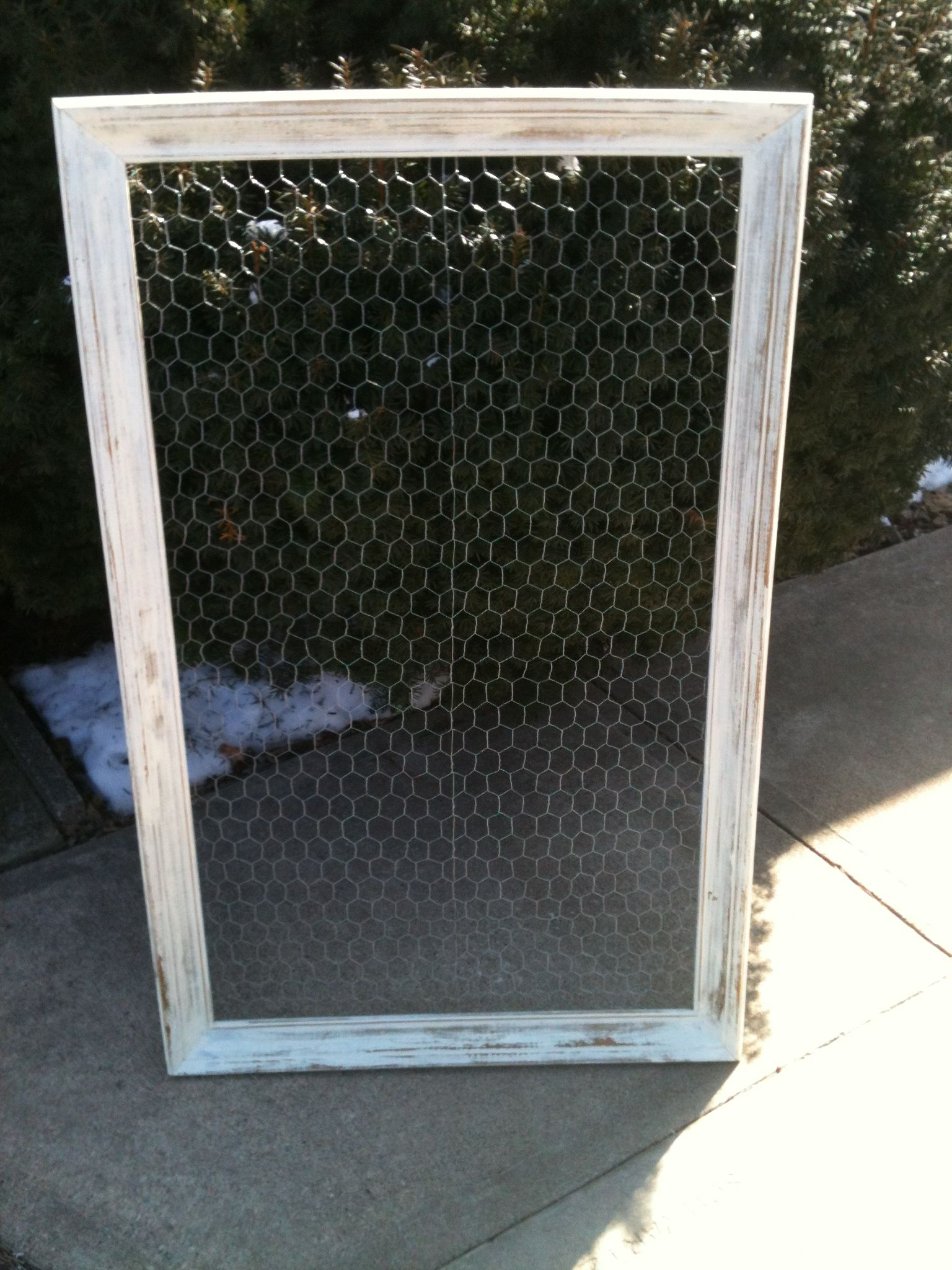 Chicken wire attached to a picture frame makes an unusual way to ...