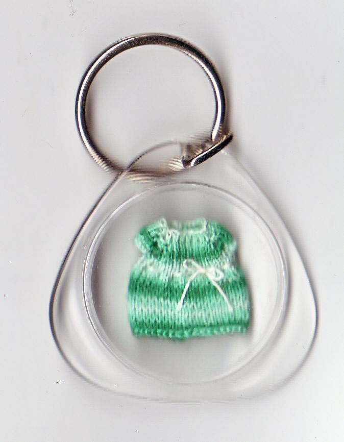1/48 scale knitted dress in a key ring. donated to a fund raising auction.